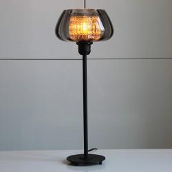 Modern svart metallfot har fått ny rökfärgad glaskupa från 40-talet tillsammans med en mönstarad genomskinlig glaskupa.